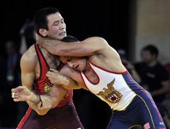 olympics: wrestling revamps rules in fight for survival